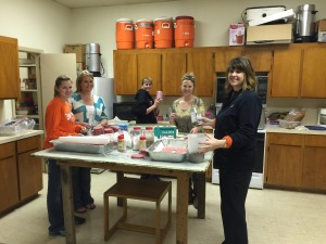 Ladies of the Crabbs Prairie VFD Ladies Auxiliary spend Friday night preparing for their annual fundraiser on Saturday.