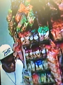 Photo from the 3/28/15 Foodmart robbery of one of the suspects