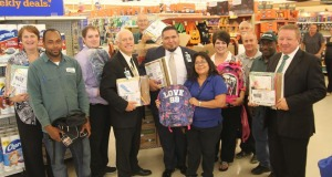 Kroger personnel are pictured here giving the donations to Huntsville ISD Administrative leaders and staff.