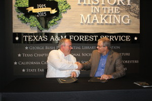 Oct 2015: (left to right) Tom Boggus, Texas state forester and director of Texas A&M Forest Service and Mark Van Every, forest supervisor for the USDA Forest Service National Forest and Grasslands in Texas, sealing a Good Neighbor Authority agreement.