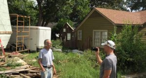 Dan Phillips, internationally known builder, talks with HGTV cable TV representatives about work he's doing on a GA White Addition lot in Huntsville. Land speculators are trying to turn this and other lots in the neighborhood commercial. Phillips doesn't own land in the White Addition and the owner of the lot is in favor of the zoning change.