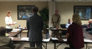 Walker County Hospital District board members Anne Karr, Dr Curtis Montgomery, and Jerry Larrison preparing to take their oath of office at the November 30, 2016 meeting.