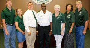 Pictured left to right: Board Secretary Trey Wharton, Trustee Dr. Karin Olson Williams; Trustee Sam Moak; Trustee Patrick Antwi; Board President Tracy Stoudt; Board Vice President Rissie Owens; and Trustee J.T. Langley